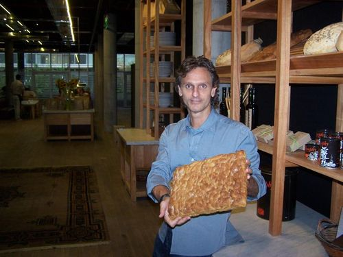 Pablo Massey showing off his bread at La Panaderia