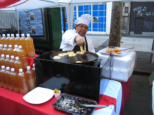 Making picarones, a deep fried squash based dough served with fruits syrup, at the Peruvian festival in Buenos Aires, July 2012