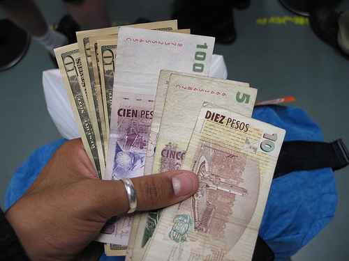 Changing dollars and euros to Argentine pesos