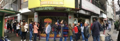 Crowd waiting in line for locro at Ña Serapia